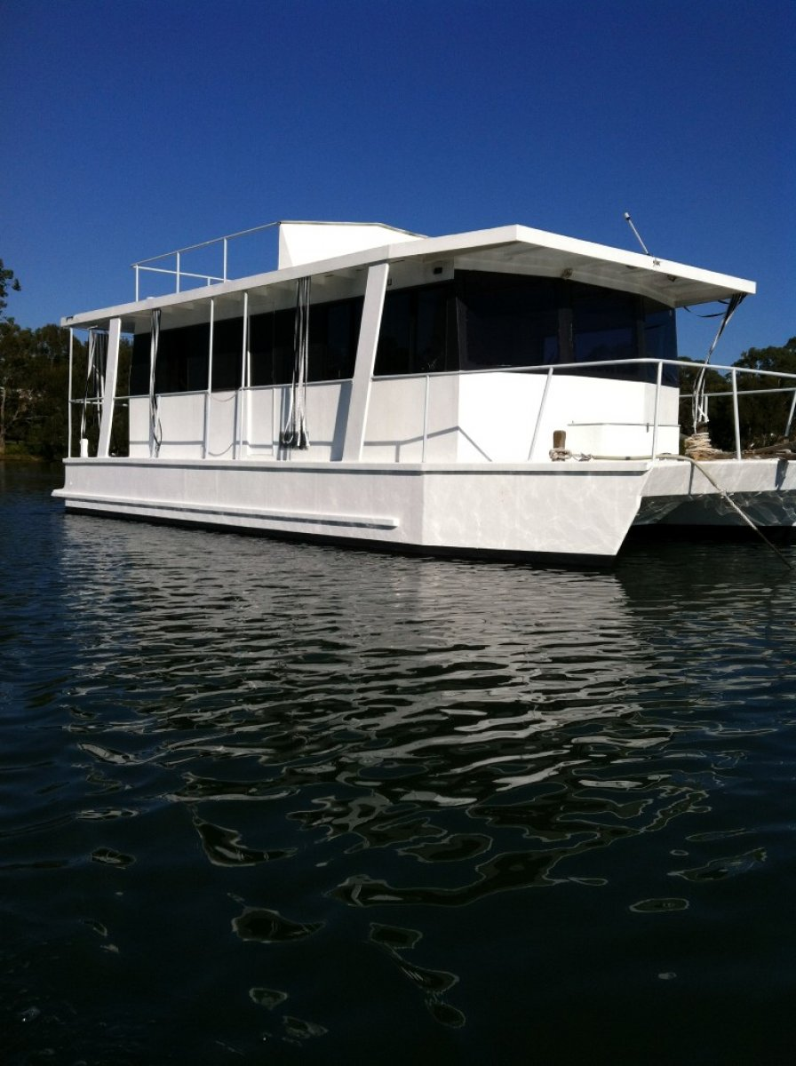Custom 40ft twin hull fibreglass Houseboat with inboard diesel.