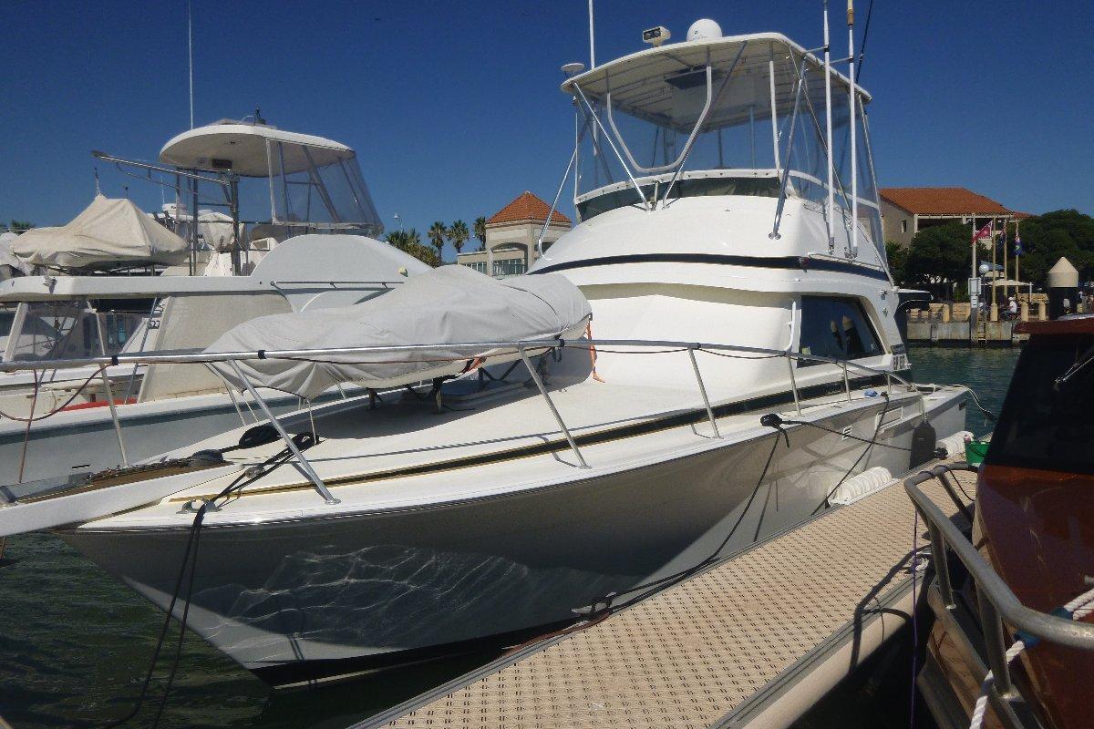 Bertram 37 Flybridge:Side View: In Marina