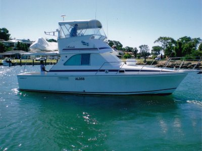 Caribbean 35 Flybridge Cruiser (1995) **Photos coming soon**