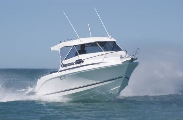 Caribbean 2400 on trailer and 300hp Suzuki 4 stroke outboard