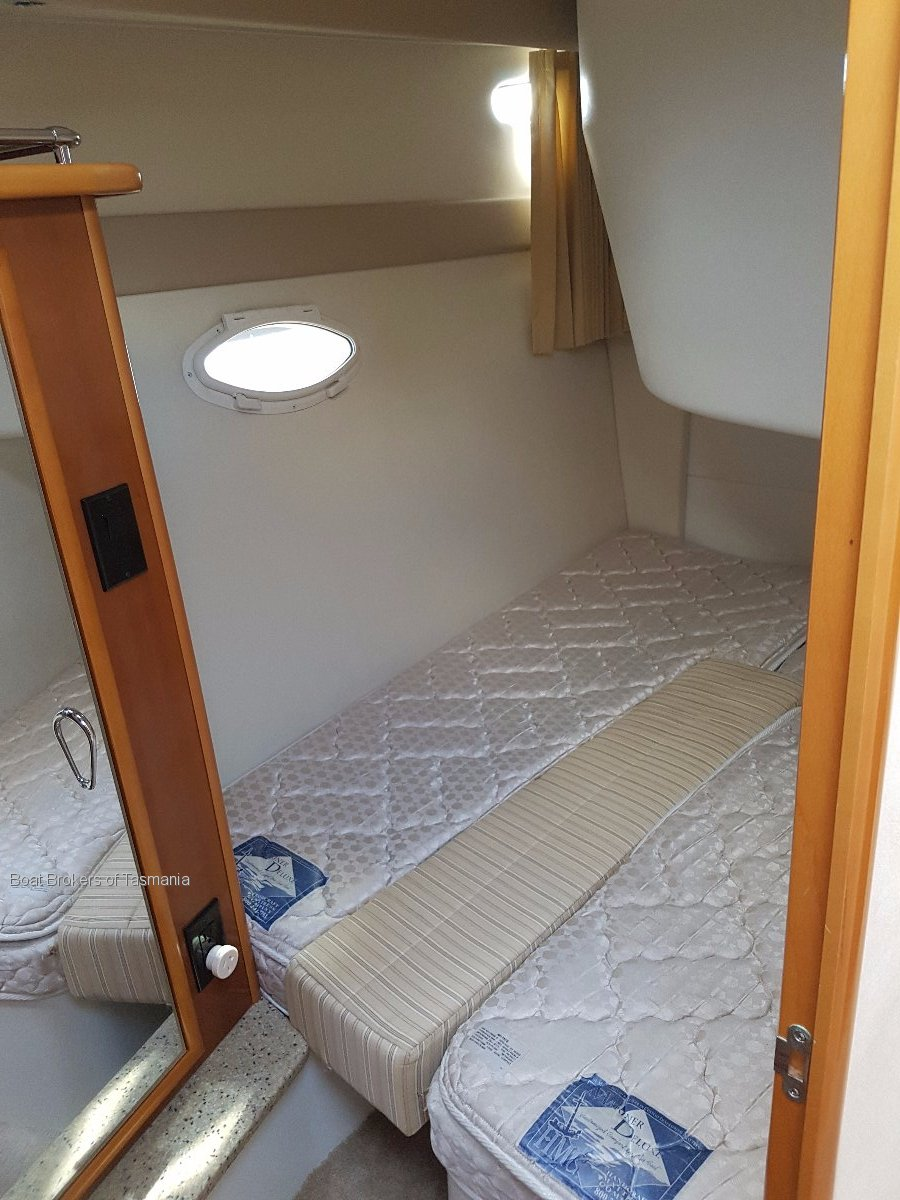 Carver 33 Super Sport 38 feet LOA and loaded with features. Boat Brokers of Tasmania