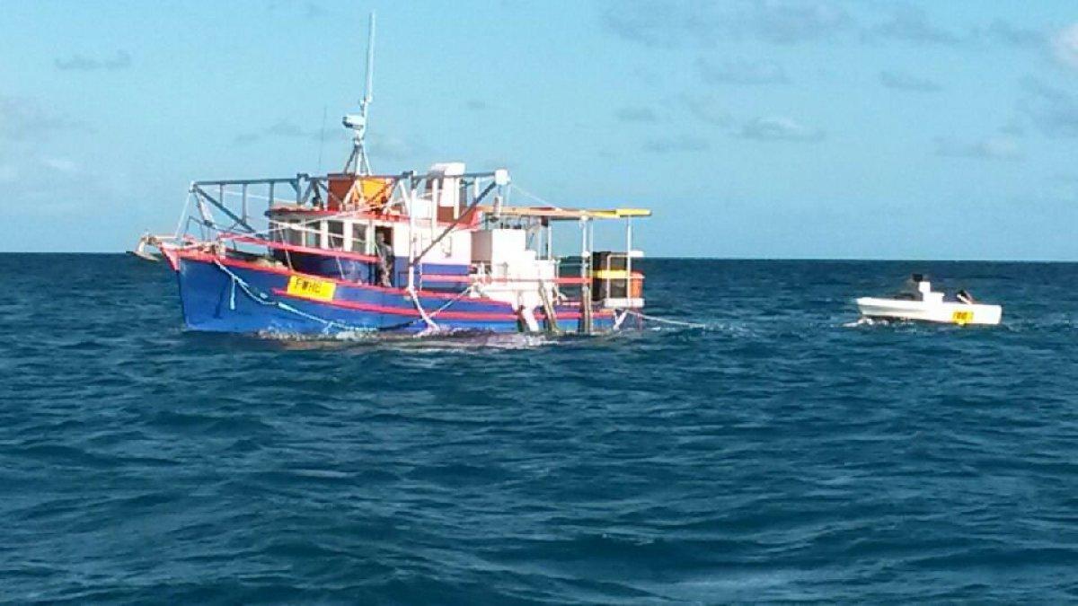 Heavily built, plank carvel motor boat