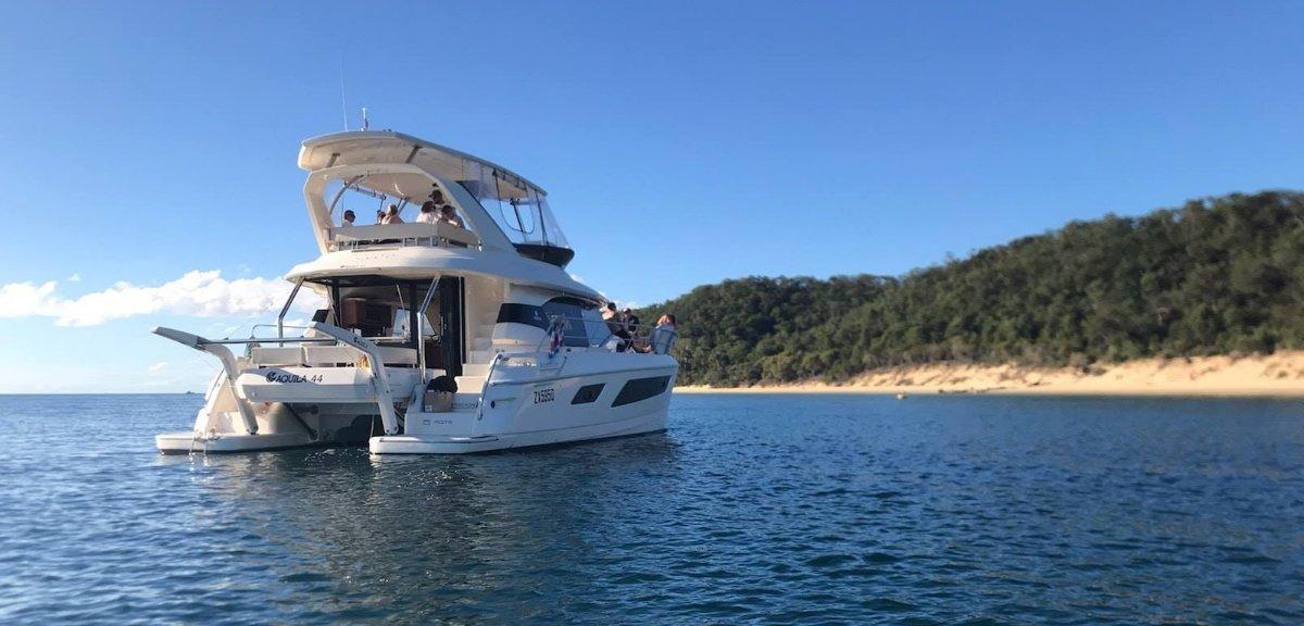 Aquila 44 Power Catamaran boat share:At Anchor at Tangalooma