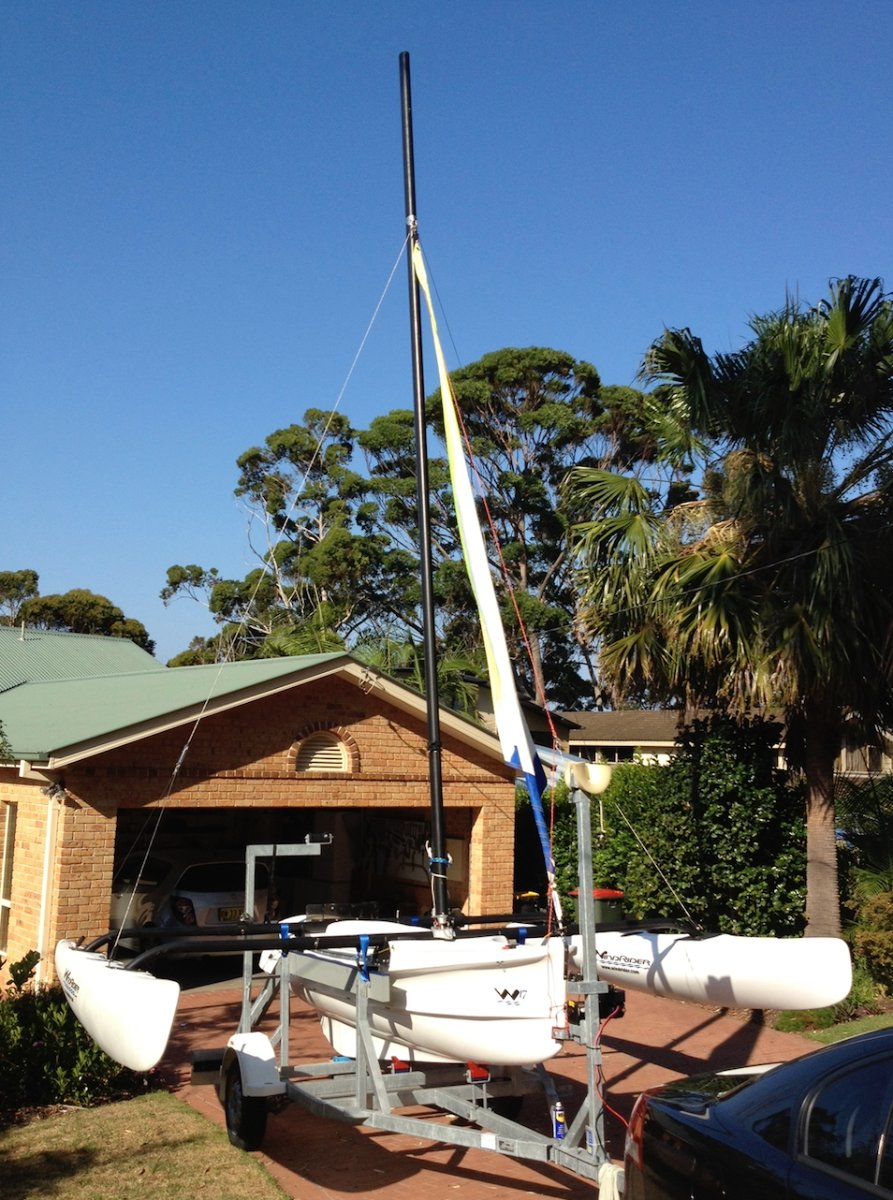 Windrider 17 2012 with Mercury outboard and trailer:outriggers telescope in for trailing
