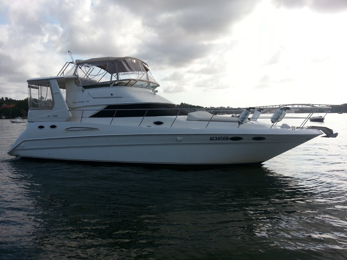 Sea Ray 420 Aft Cabin:Side view, what a beauty, showing all new clears throughout