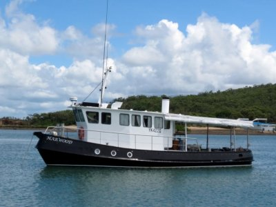 Converted Tug Boat