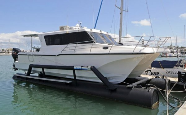 Ozycat 10.0 Catamaran Designed by Cougar Cat and Custom Float Dock