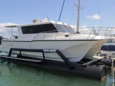 Ozycat 10.0 Catamaran Designed by Cougar Cat and Custom Float Dock