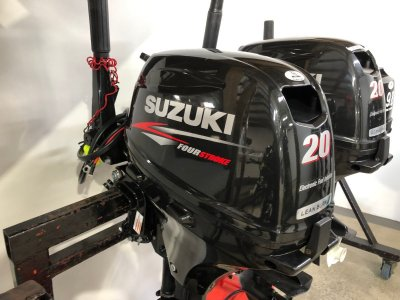 2013 Suzuki 20hp 4 st tiller with electric start (51 hours )