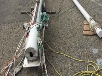 Yacht mast and boom for sale with standing and running rigging.