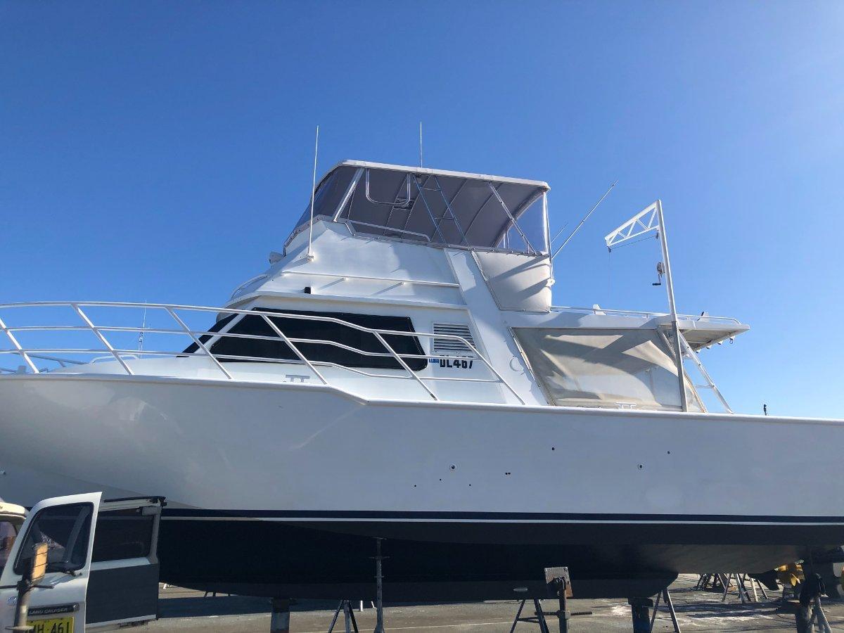 Jackman Flybridge cruiser with mooring.