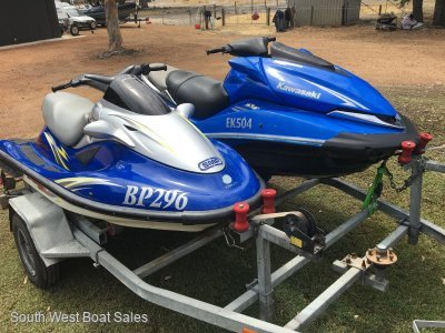 Kawasaki Ultra 250X And Ultra 150 on registered tandem trailer