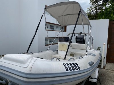 Caribe CL14 (2008) with 75hp Mercury and trailer.