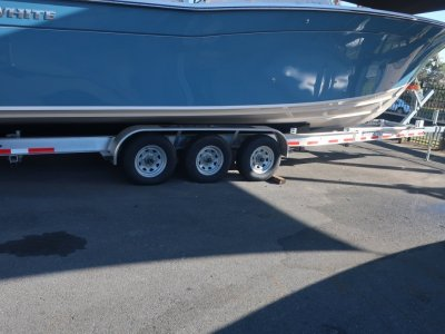 NEW - MAGIC TILT TRIPLE AXLE ALLOY TRAILER