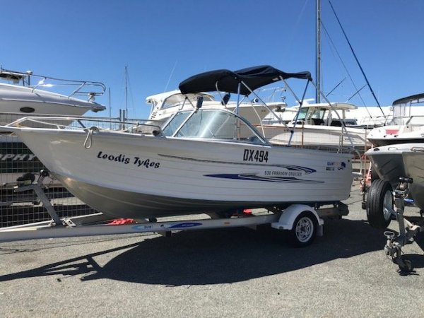 Quintrex 530 Freedom Cruiser Bowrider on registered dual axle trailer