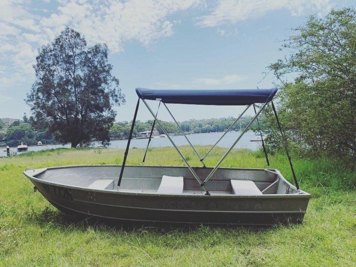 Custom Tinny dinghy 12 ft just in with Bimini
