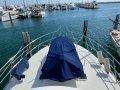 Precision Marine 45 SPORT FISHER FLYBRIDGE CRUISER:Foredeck View with Tender and Crane